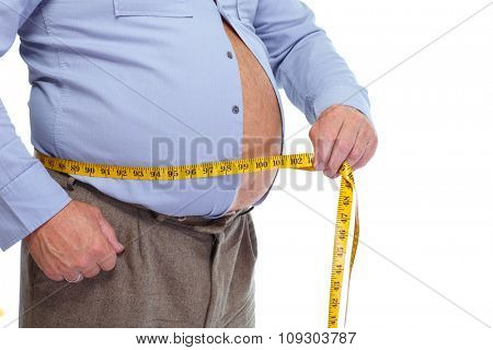 Fat man measuring his big stomach. Weight loss concept.