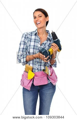 Woman with a drill. House renovation and repair concept.
