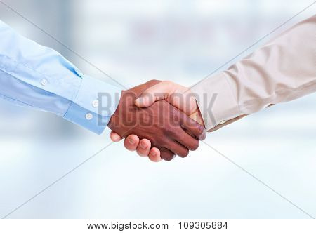 Handshake. Hands of businessman business meeting and teamwork background.