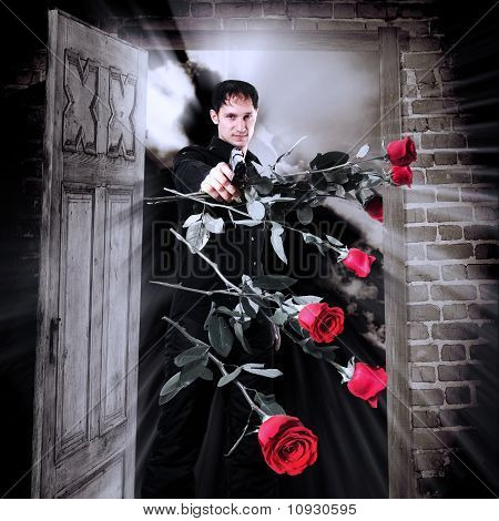 Man Killer With Gun And Red Roses