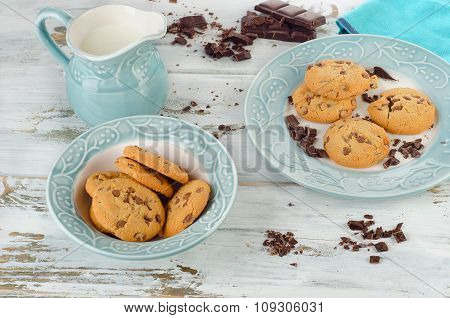 Chocolate Chip Cookies With Milk In Jug On Wooden Background.
