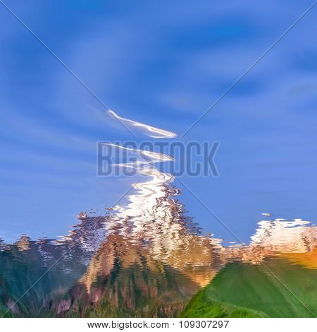 natural landscape with sky and mountains reflected in water