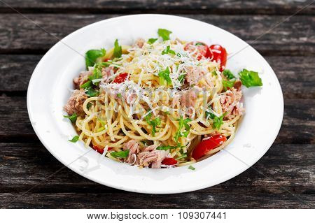 Italian Tuna Pasta Spaghetti With Tomato, Chilli, Parmesan And Wild Rocket  Lives. On Old Wooden Tab
