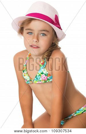 girl in a bathing suit and hat