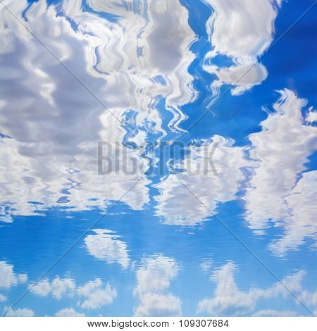 natural landscape with blue sky reflected in water