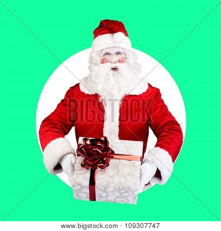 Santa Claus with gift posing on color white green background
