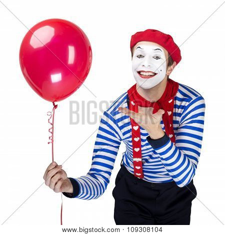 Mime with balloon.Emotional funny actor wearing sailor suit, red beret posing on white isolated back
