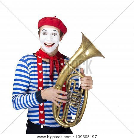 Mime with trombone.Emotional funny actor wearing sailor suit, red beret posing on white isolated bac