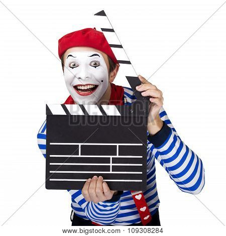 Emotional funny mime actor wearing sailor suit, red beret posing on white isolated background.
