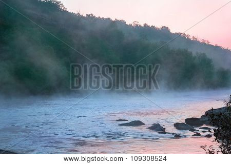 Landscape Of River With Mist And Mountains With Trees And Reflection Sunrise
