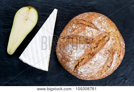 Fresh Bread With Pear And Cheese On Old Blue Stone Background.