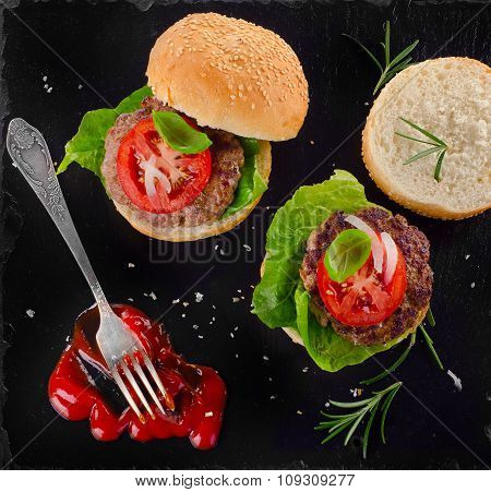 Homemade Burgers With Tomato Sauce On Dark Background.