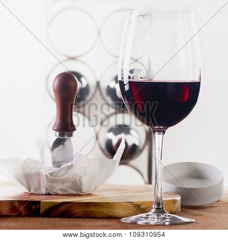 Red Wine Glass With Bottles And Cheese.