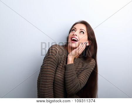 Excited Surprising Young Woman With Open Mouth Looking Up