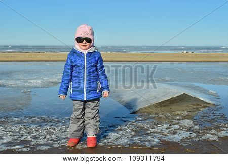 The Little Girl In Big Sunglasses On Ice