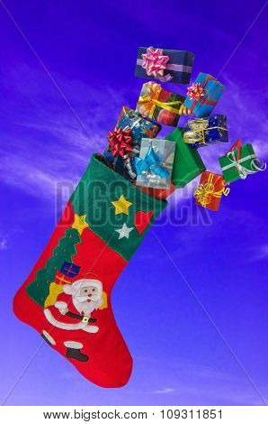 Christmas Stocking And Gifts In The Sky.