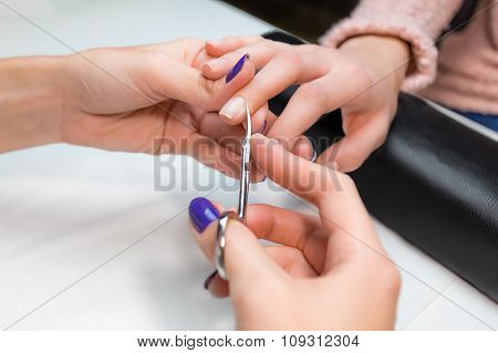 Cuticle clipping, cutting skins manicure treatment