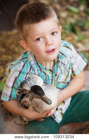 Adorable Child With Duck