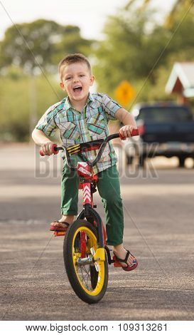 Laughing Child On Bike