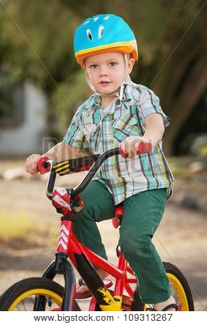 Child In Bike Helmet Riding