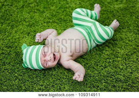 Crying Baby On The Soft Rug