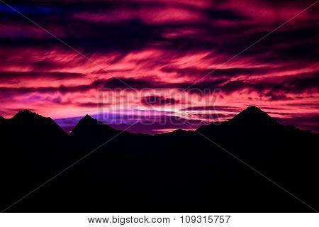 Mountain Peaks At Sunset