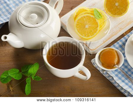 Teapot And Cup With Tea With Lemon
