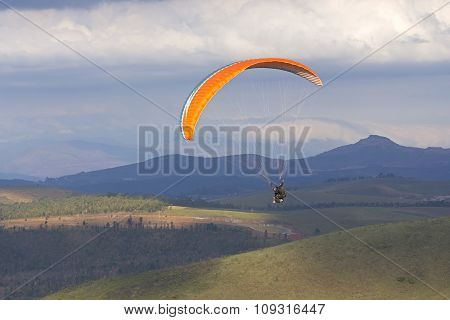 Paragliding Over Hilly Valley