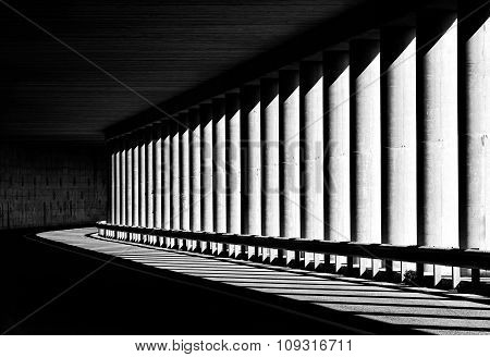 Tunnel with columns in black and white photo, abstract tunnel photo, black and white photo, architec