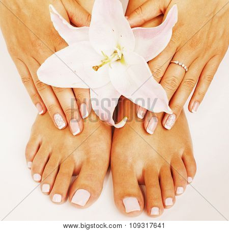 manicure pedicure with flower lily close up isolated on white perfect shape hands spa salon