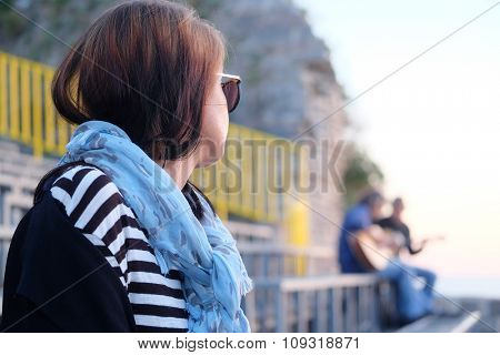 Portrait of a young girl listening the music