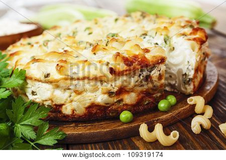 Casserole Of Pasta With Green Peas, Zucchini And Curd