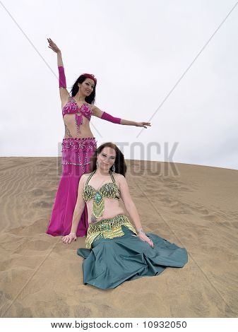 Arab Style Dancers Resting At Desert