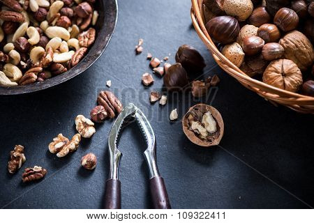 Mixed Nuts In Basket And Nut Cracker From Above