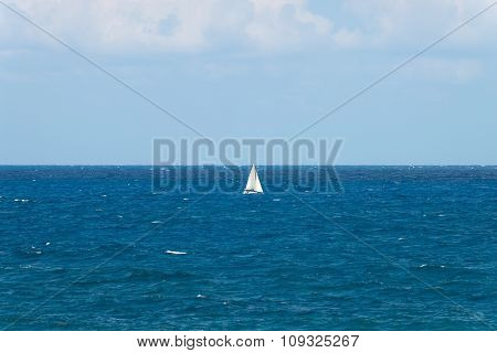 Peaceful Ocean Landscape With A White Yacht Afar Off.