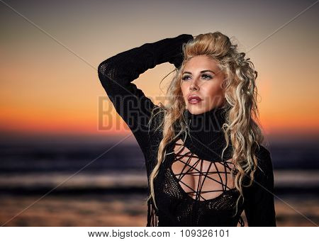 Beautiful Woman On The Beach At Sunrise