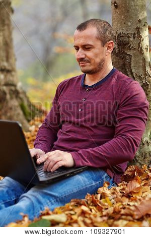Businessman With Laptop Working Outdoor