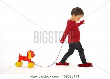 Girl who Pulls A Dog Toy On Wheel