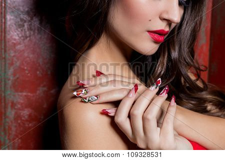 beautiful well-groomed hands of a young girl with long fake acrylic nails with a festive Christmas