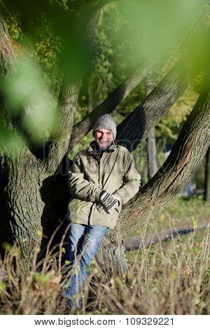 Mature man in autumn park