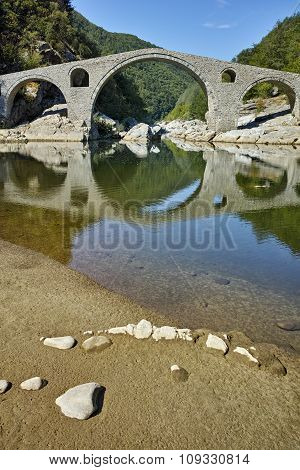 Reflection of Devil's Bridge in Arda river