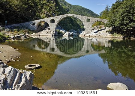 Reflection of Devil's Bridge in Arda river, Bulgaria