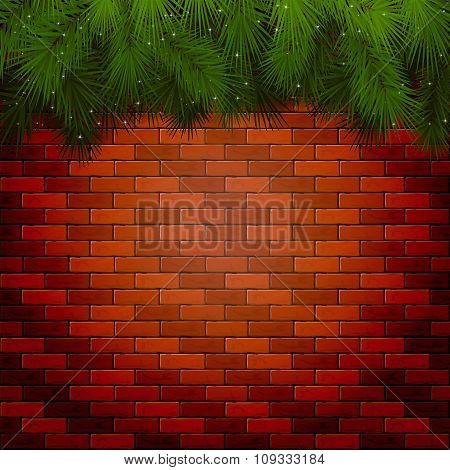 Christmas Background With Spruce Branches On A Brick Wall