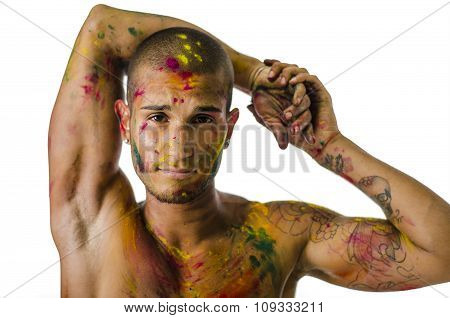 Head and shoulders shot of attractive young man shirtless, skin painted all over with bright Holi colors, looking at camera, isolated on white background ** Note: Visible grain at 100%, best at smaller sizes