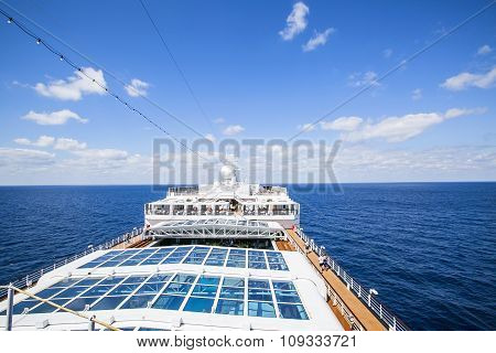 Cruise Ship. Tourists Relax And Take A Sun Bath On The Upper Deck.