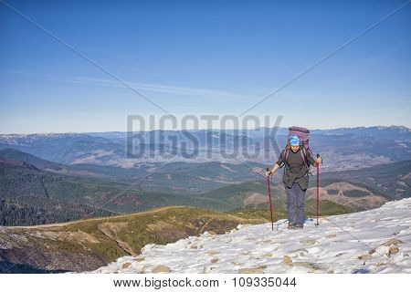 Climber With A Backpack Is On A Slope.
