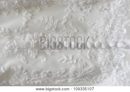 Fragment Of Wedding Dress With Buttons