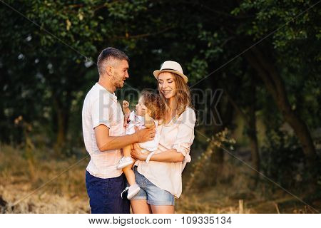 Father, mother and daughter in the park