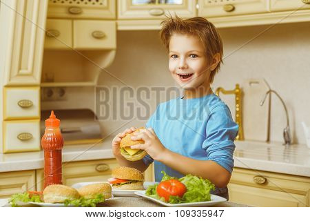 smiling happy boy holding homemade hamburgers or sandwiches