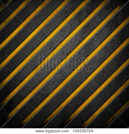 crude metal with black and yellow stripes
